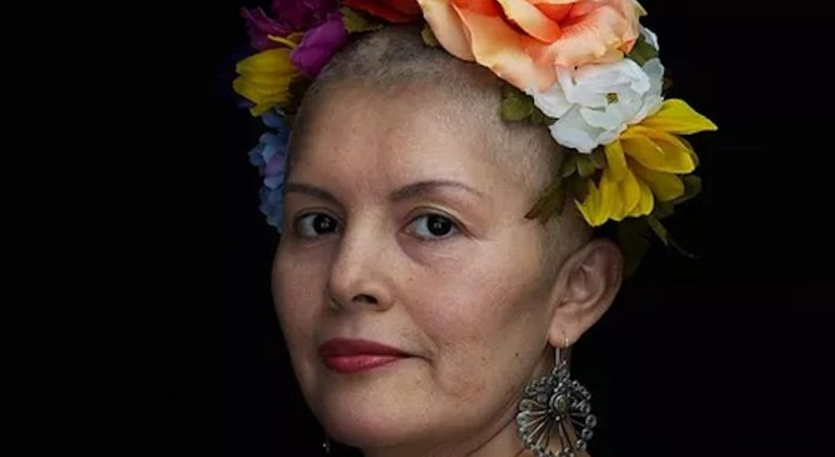 A woman with a colorful floral headband on her head.