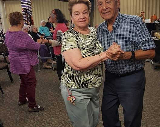 two people dance at Lytton Gardens