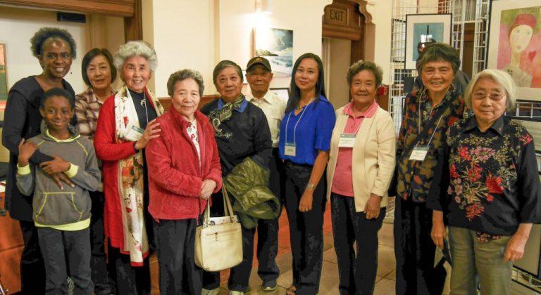 A group of art program participants smiling