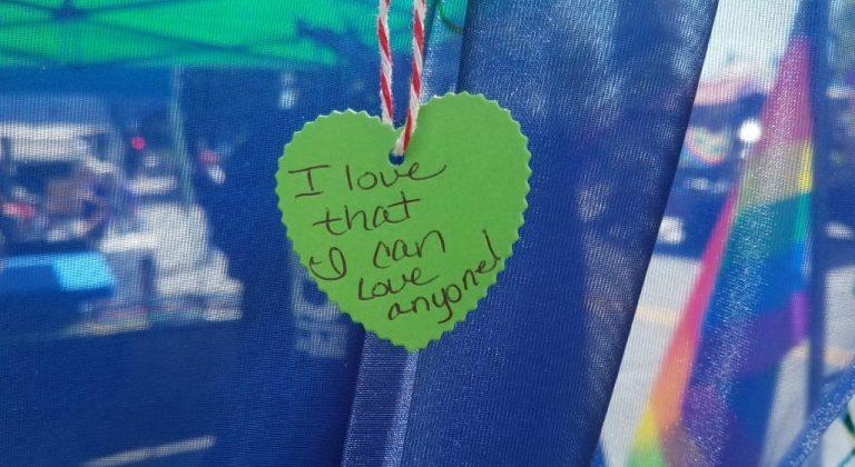 "a cutout heart that says ""I love that I can love anyone!"""