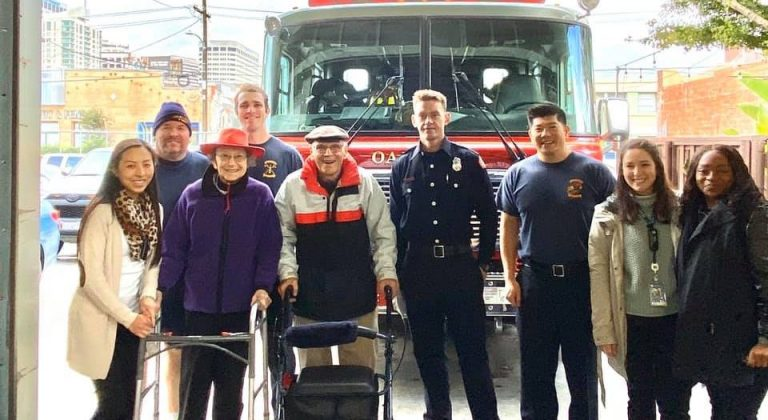 Covia employees and residents standing in front of a firetruck with some fireman