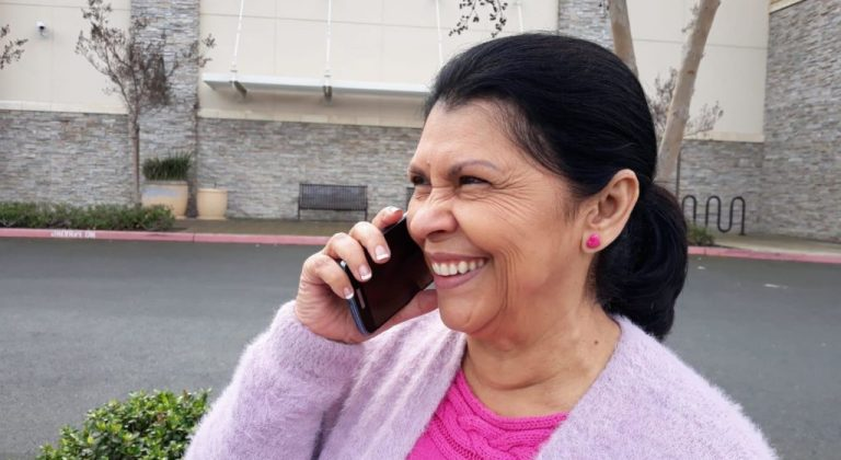 person on the phone, smiling