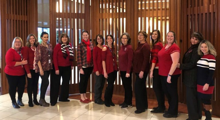 A group of Covia employees wearing red for national Wear red day