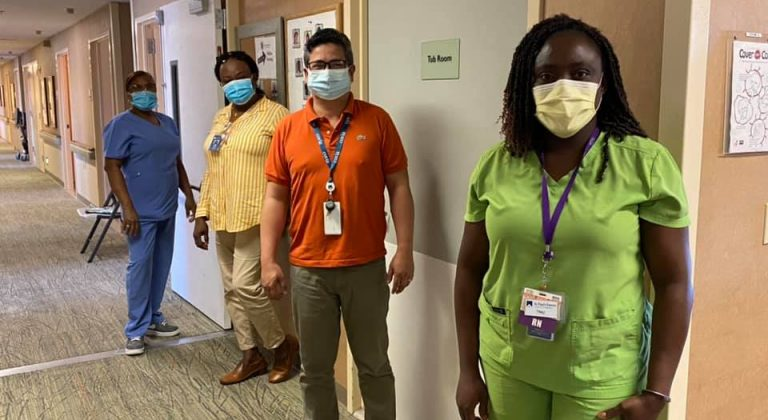 Four hospital staff members wearing face masks