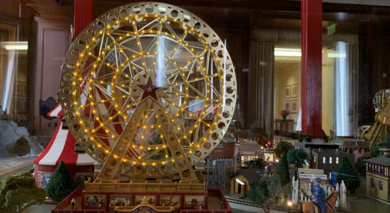 Close up of a toy ferris wheel on top of the San Francisco Towers Christmas Circus Wagon