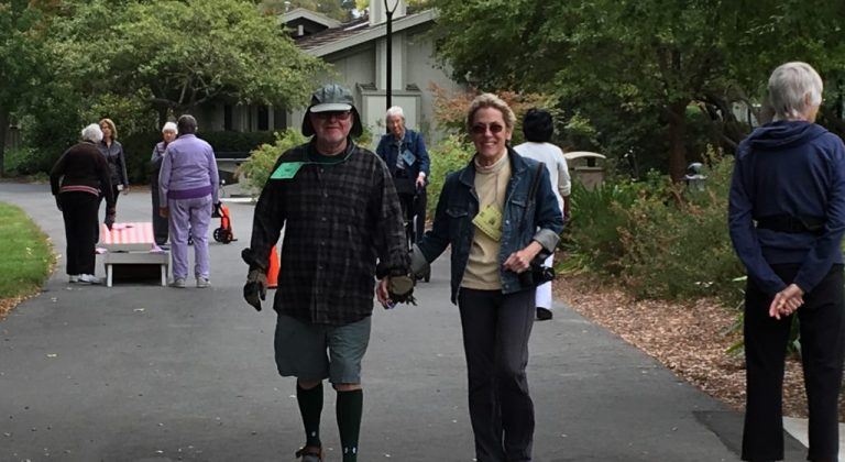 image of two people walking and holding hands