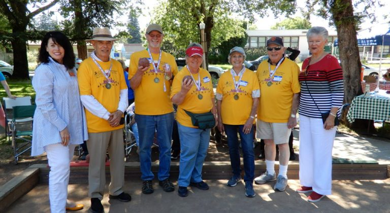 A group of residents receiving medals for the Senior Games