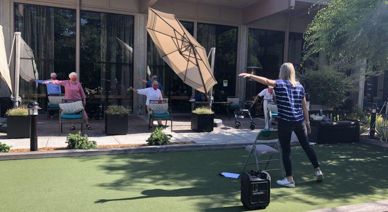Spring Lake Village residents enjoy an outdoor exercise class