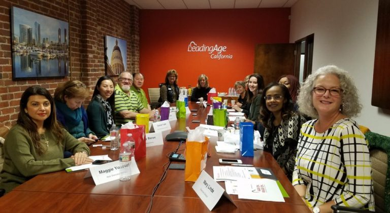 Covia Employees sitting together in a meeting at Leading Age California
