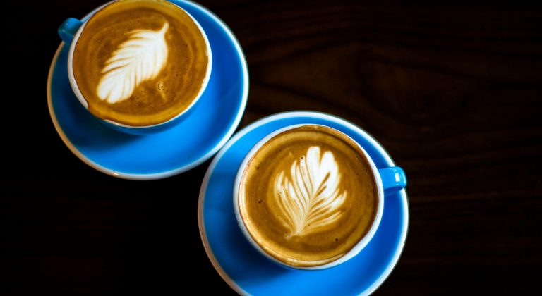 two blue cups of cappuccino