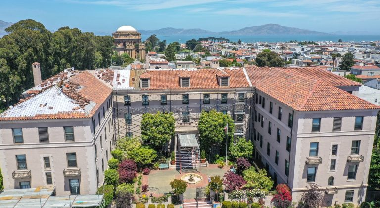 A top down view Presidio Gate Apartments with the city of San Francisco in the background