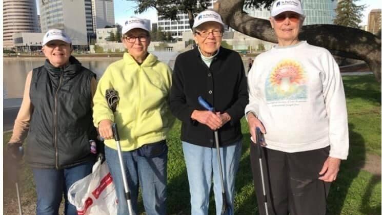 Four SPT residents pose while walking around Lake Merritt