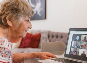 A resident talks to a group on Zoom