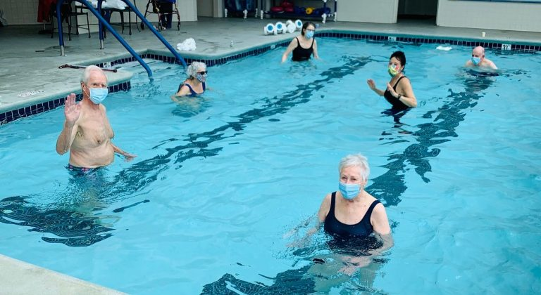 San Francisco Towers residents stand in the pool