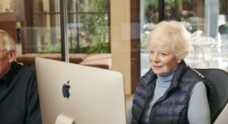 A SLV resident sits at a computer